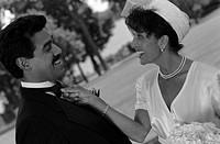 Bride Straightening Groom´s Bow Tie