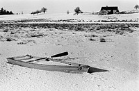 Rowboat in a Snow Covered Field