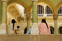 Low angle view of two women sitting inside a museum, Government Central Museum, Jaipur, Rajasthan, India