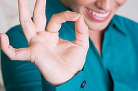 Close-up of a businesswoman making an ok sign