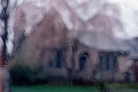 Blurred house shot through glass