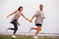 Jogging couple, holding hands