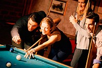 Group of young adults, playing pool