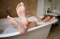 21 year old girl in the bath, smiling to camera