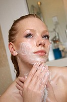 21 year old girl in the bath washing her face