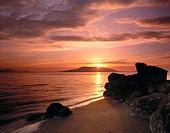 Sunset over Samish Bay from Larrabee State Park, San Juan Islands in the distance. Washington, USA