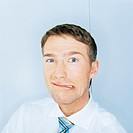 Businessman pulling face, portrait, close-up