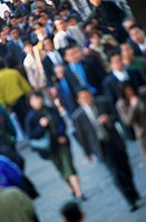 Business commuters on city street (defocused)