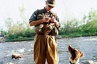 Man Baiting Fly-Fishing Hook