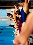 Swimming Coach Talking to an Athlete