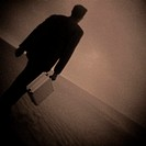 Businessman Walking in the Desert
