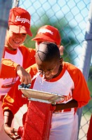 Child Baseball Player Drinking From Fountain