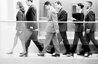 Businesspeople walking, profile (B&W)