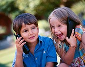 Two Children Talking on Cellular Phones