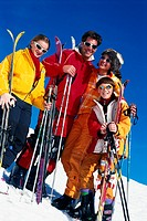Family with ski gear standing on slopes