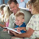 Family reading Bible in Church