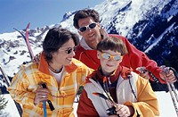 Parents with son (12-13) skiing in mountains