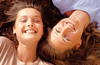 Two young women smiling, portrait, overhead view, close-up