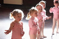 Group of 3 year old girls in ballet class, dressed in pink leotards