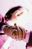 Man and woman shaking hands, low angle