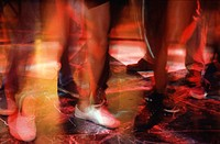People on dance floor. close-up of low section
