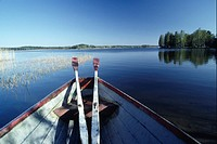 Two oars lying on bow of boat, Lake Region, Finland
