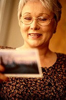 Mature Woman Reading a Postcard
