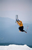 Skier doing backflip, mid-air