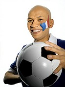 Male french soccer fan holding a soccer ball
