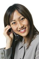 close up shot of a young adult woman wearing a phone headset as she smiles