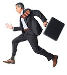 a caucasian business man in a dark suit runs briskly holding his briefcase