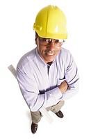 an african american general contractor wearing a hard hat and holding plans smiles as he looks up at the camera