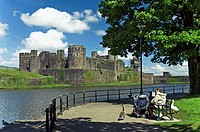 Mother with pram, Caerphilly castle,mid glamorgan, Wales, GB