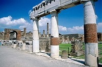 Forum and Neron's arch in background, ruins of the old Roman city. Pompeii. Italy