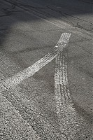 Tire tracks on asphalt roadway