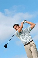 Portrait of a man making a golf swing (thumbnail)