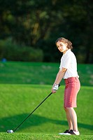 A young woman contemplates before playing a shot (thumbnail)