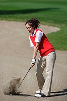 Woman playing a bunker shot