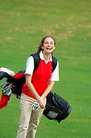 Happy female golfer