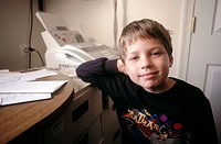 Little boy in home office, USA