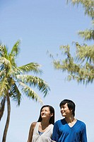 Couple by palm trees