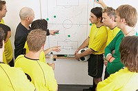 Coach discussing strategy with soccer team (thumbnail)