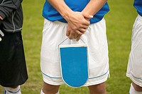 Footballer holding shield