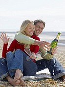 Couple on the beach with champagne