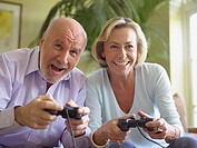 Mature couple playing computer game