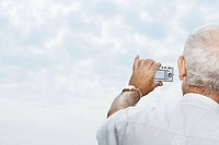 Man taking a picture of the sky (thumbnail)