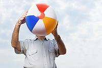Man holding a beachball