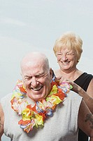Woman putting a flower garland on husband