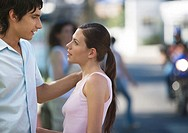 Young couple talking to each other in urban environment