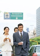 Group of business associates walking with coffees